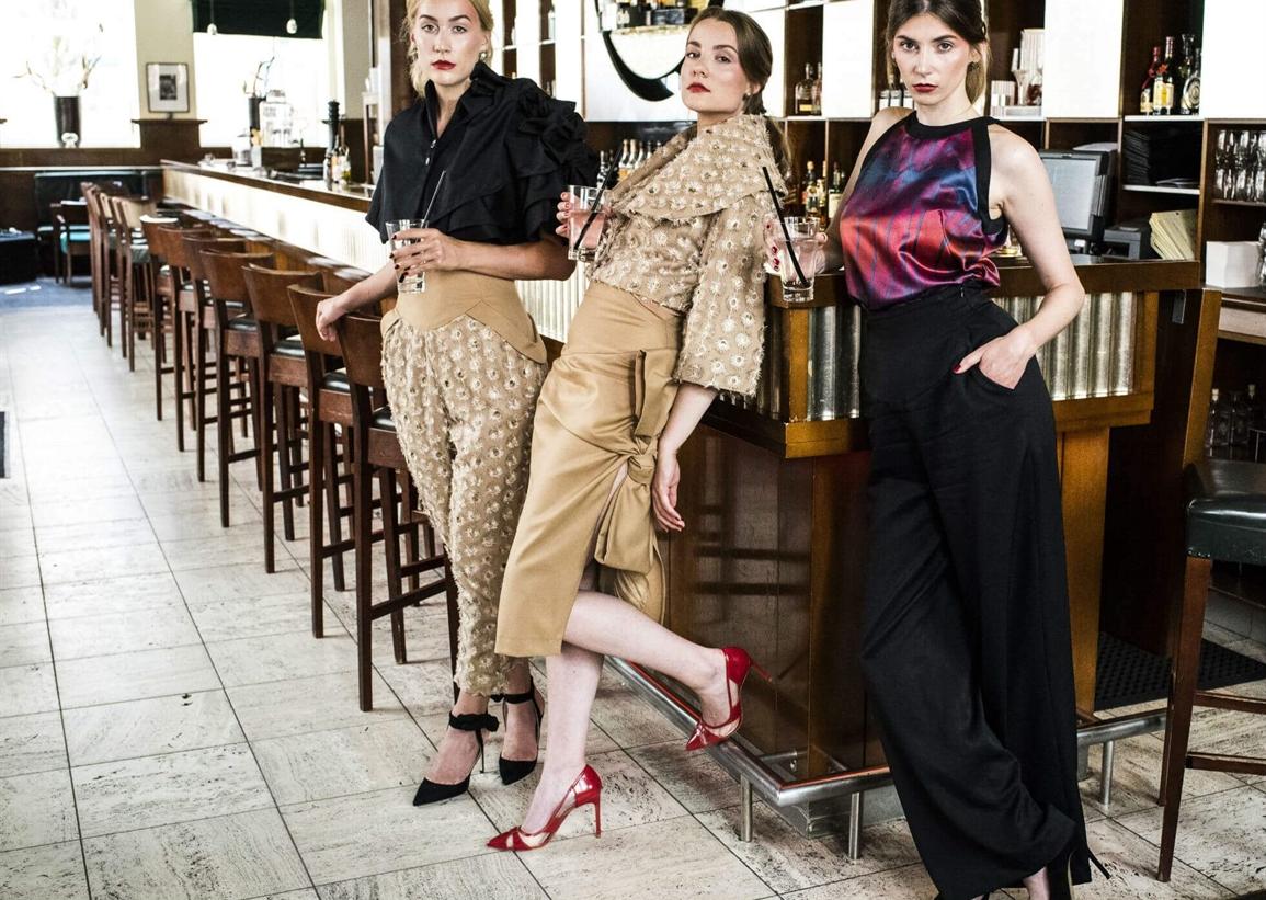 Three girls in cocktail attire